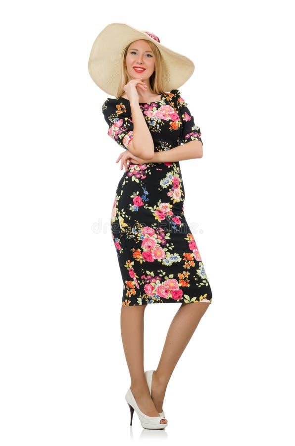 Leuk blondemeisje in bloemenkleding op wit stock foto