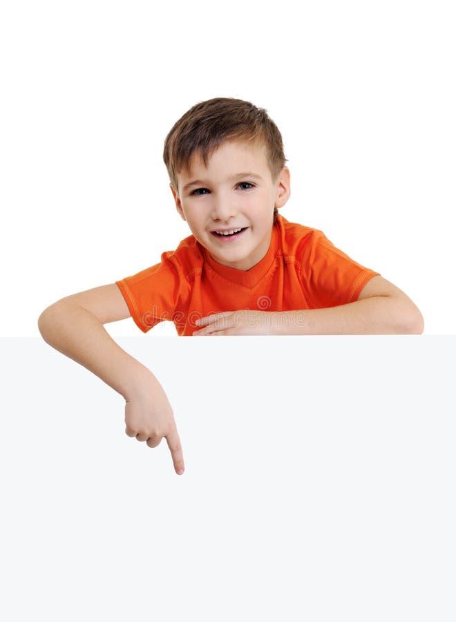 Leuk glimlachend weinig jongen en banner stock fotografie