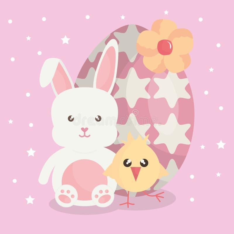 Leuk konijn met geschilderd paasei en kuiken royalty-vrije illustratie