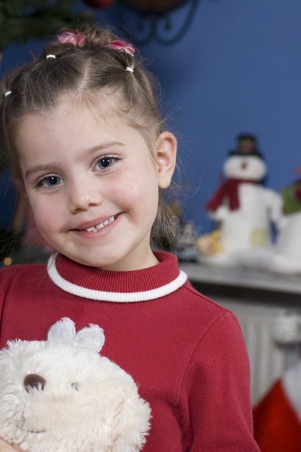 Leuk meisje in de tijd van Kerstmis stock foto's