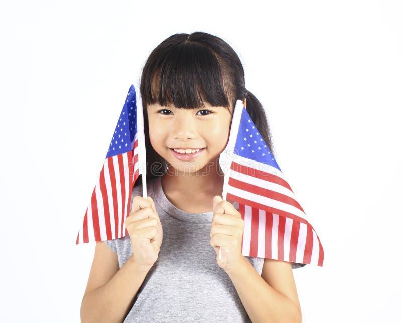 Leuk meisje die een Amerikaanse Vlag houden stock foto's