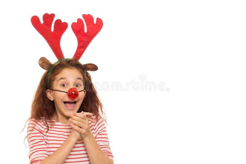 Leuk meisje die Kerstmisgeweitakken dragen stock fotografie