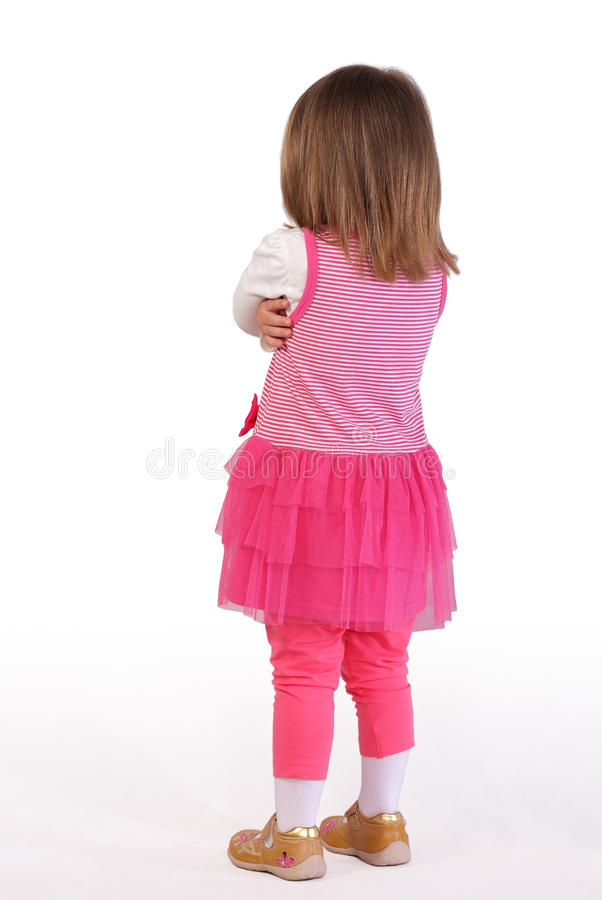 Leuk meisje in een roze kleding stock afbeeldingen