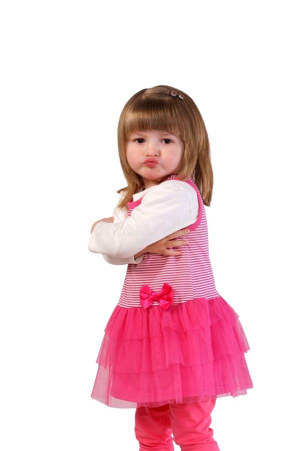 Leuk meisje in een roze kleding stock foto's