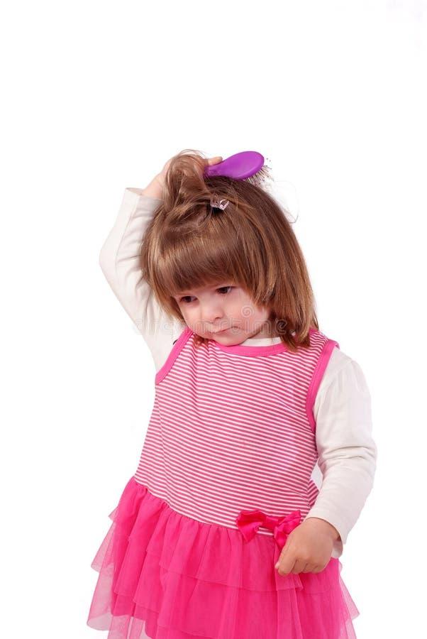 Leuk meisje in een roze kleding royalty-vrije stock fotografie