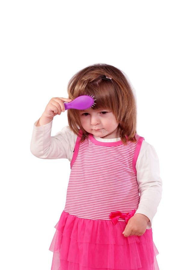 Leuk meisje in een roze kleding stock afbeelding