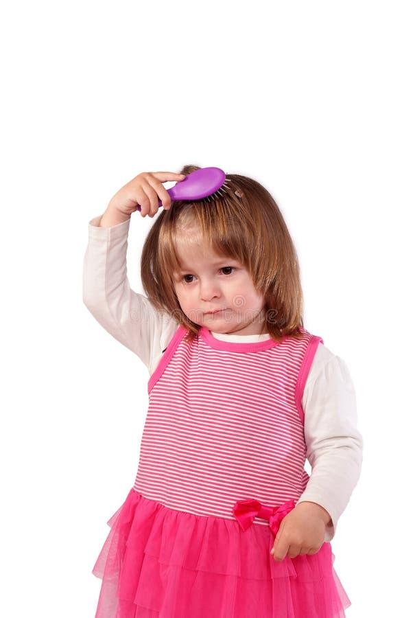 Leuk meisje in een roze kleding royalty-vrije stock afbeelding