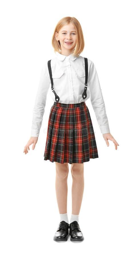 Leuk meisje in eenvormige school stock fotografie