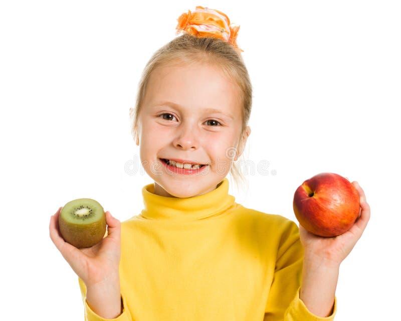 Download Leuk Meisje Met Een Appel En Een Kiwi Stock Afbeelding - Afbeelding bestaande uit binnen, hongerig: 29503819