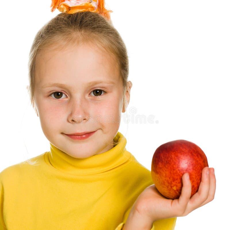 Download Leuk Meisje Met Een Appel In Zijn Hand Stock Foto - Afbeelding bestaande uit kind, huis: 29503868