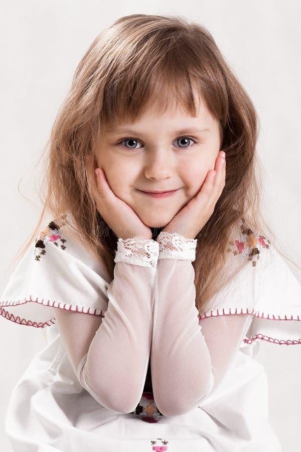 Leuk mooi meisje met blauwe ogen royalty-vrije stock foto