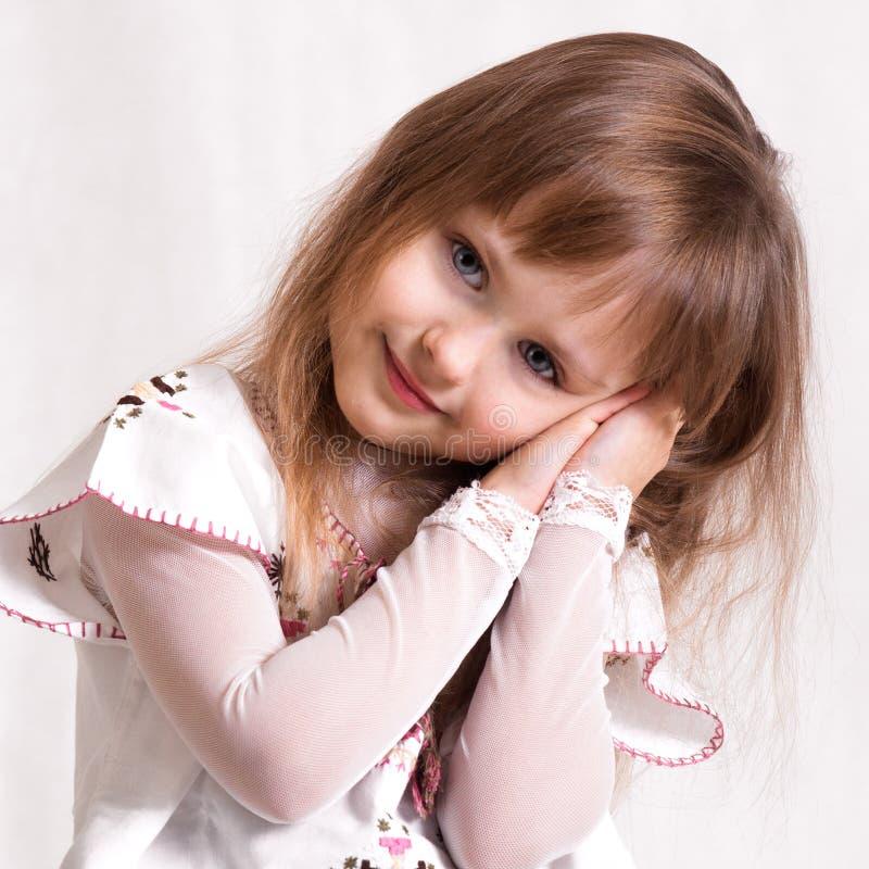 Leuk mooi meisje met blauwe ogen royalty-vrije stock afbeeldingen