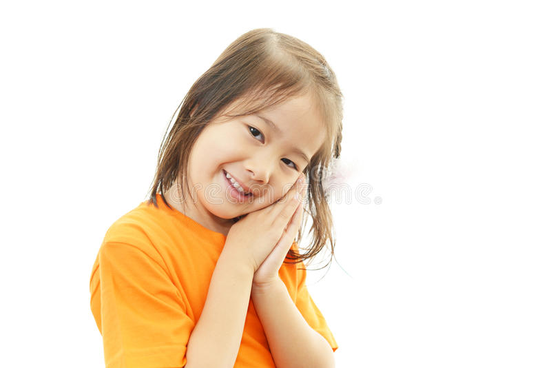 Leuk weinig het Aziatische meisje glimlachen stock afbeelding