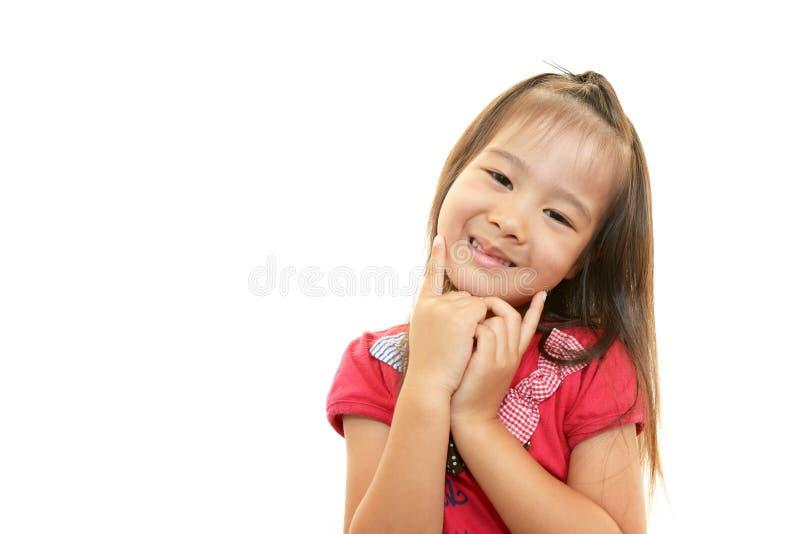 Leuk weinig het Aziatische meisje glimlachen royalty-vrije stock foto's