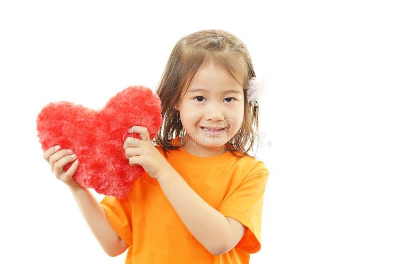 Leuk weinig het Aziatische meisje glimlachen stock foto