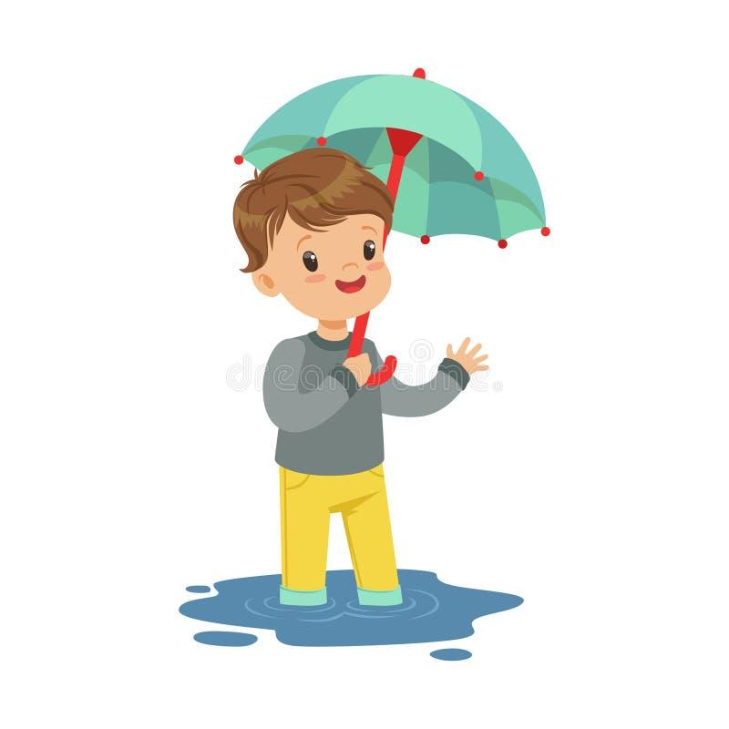 Leuk weinig jongen die zich in de vulklei bevinden en de vectorillustratie van het paraplubeeldverhaal houden stock illustratie