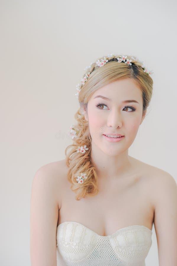 Leuke Aziatische Vrouwenmake-up en glimlach royalty-vrije stock afbeeldingen
