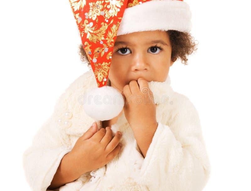 Leuke baby in de hoed en het bont van Kerstmis stock afbeeldingen