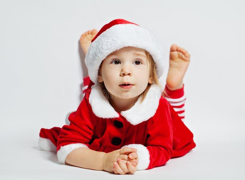Leuke Baby in de Hoed van de Kerstman Kerstmiskind royalty-vrije stock afbeelding