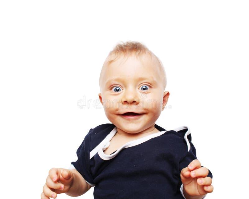 Leuke babyjongen die - zeven maanden oud glimlachen royalty-vrije stock fotografie
