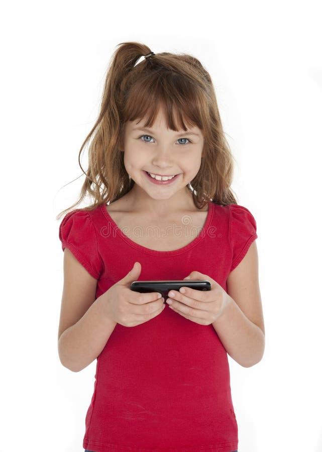 Leuke de celtelefoon van de meisjeholding stock afbeelding