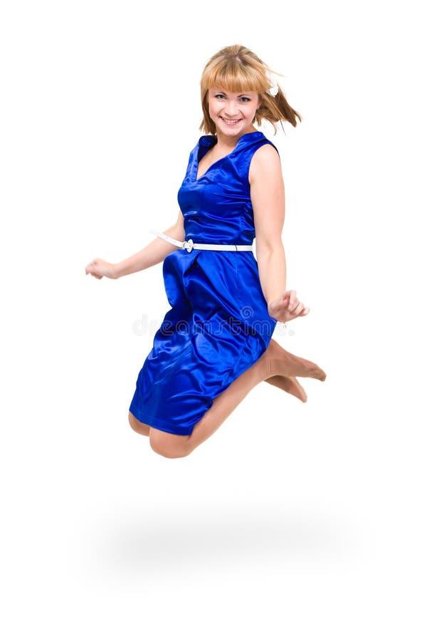 Leuke elegante vrouw in het blauwe kleding springen royalty-vrije stock foto's