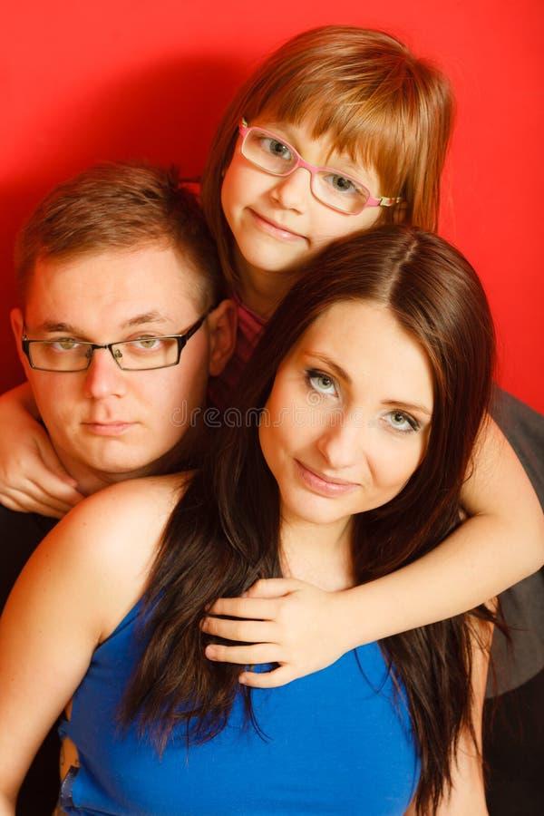 Leuke familie van drie gezichtsportret stock afbeelding