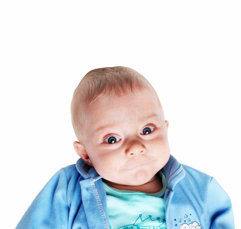 Leuke glimlachende babyjongen - vijf maanden oud stock fotografie