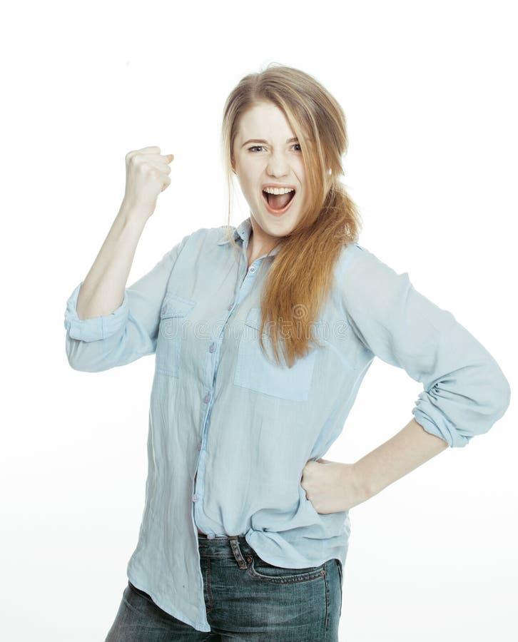 Leuke jonge vrouw die vrolijke gezichten op wit maken stock foto's