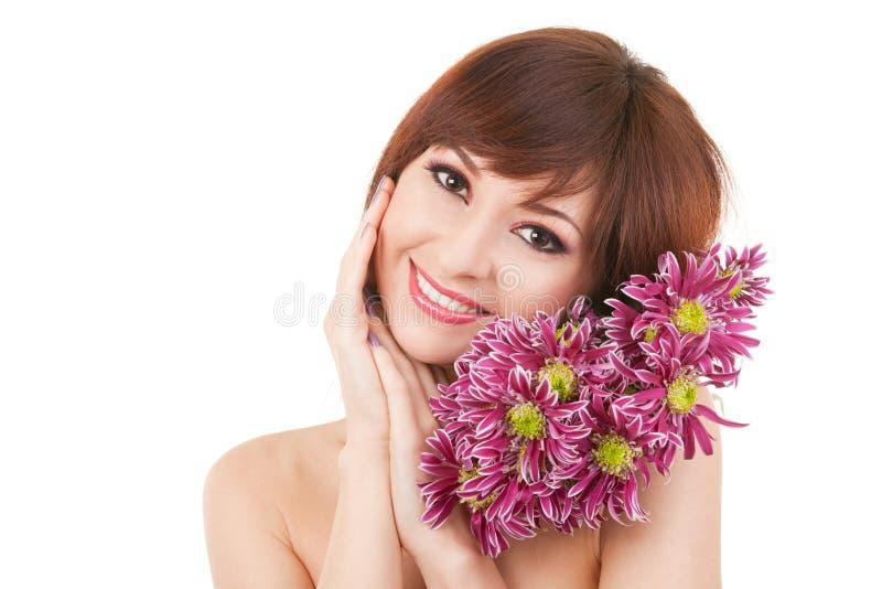 Leuke vrouw met bloemen royalty-vrije stock foto