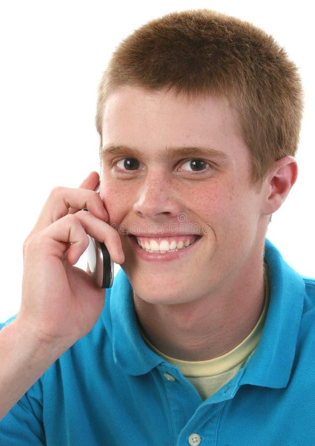 Leuke Mannelijke Tiener op Cellphone stock fotografie