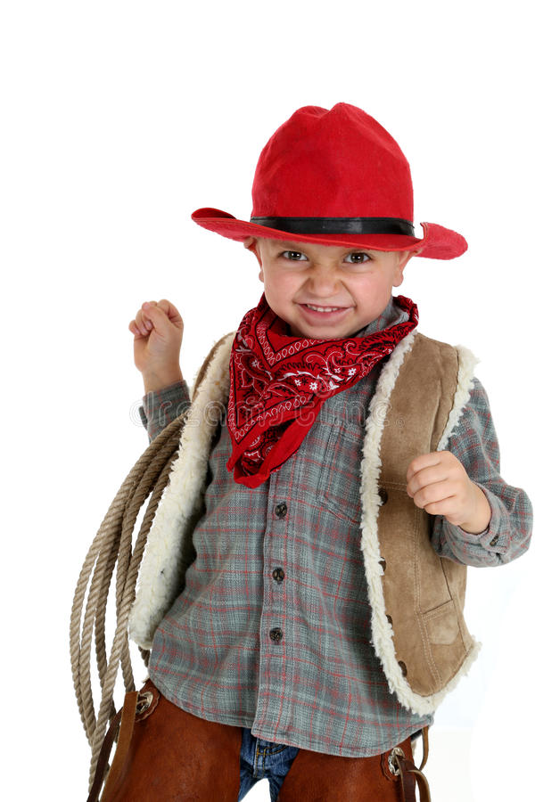 Leuke peutercowboy die houdend een kabel die een rode hoed dragen glimlachen stock afbeeldingen