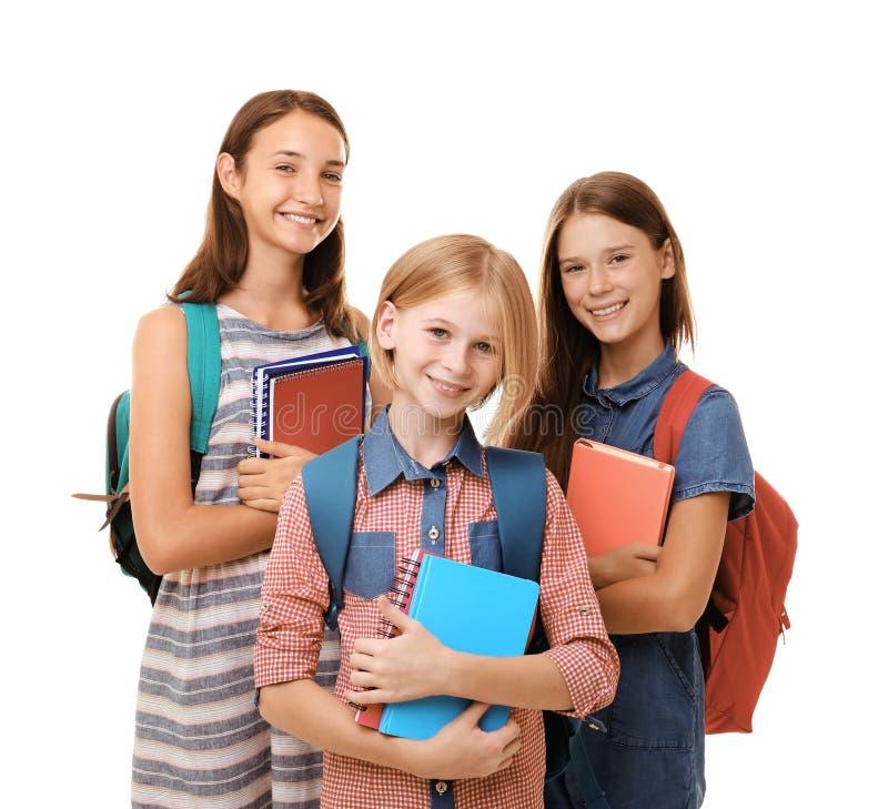 Leuke tienermeisjes die die notitieboekjes houden, op wit worden geïsoleerd royalty-vrije stock afbeelding