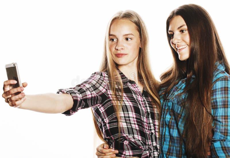 Leuke tieners die selfie geïsoleerd maken stock afbeeldingen