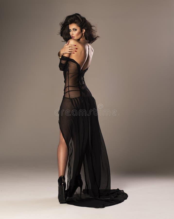 Leuke vrouw in kleding stock foto