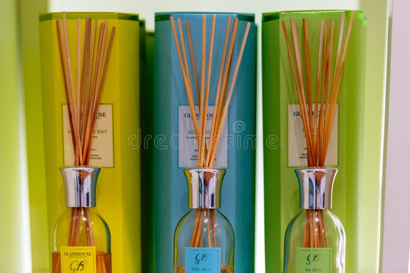 Different coloured perfume air wicks on display in a store in their packaging royalty free stock image