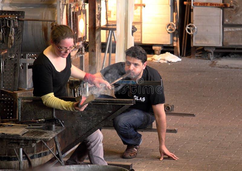 Glass blowers demonstrate their craft in a popular tourist attraction in Leusden. Leusden, Netherlands - April 9 2016: Glass blowers demonstrate their craft in a stock photos