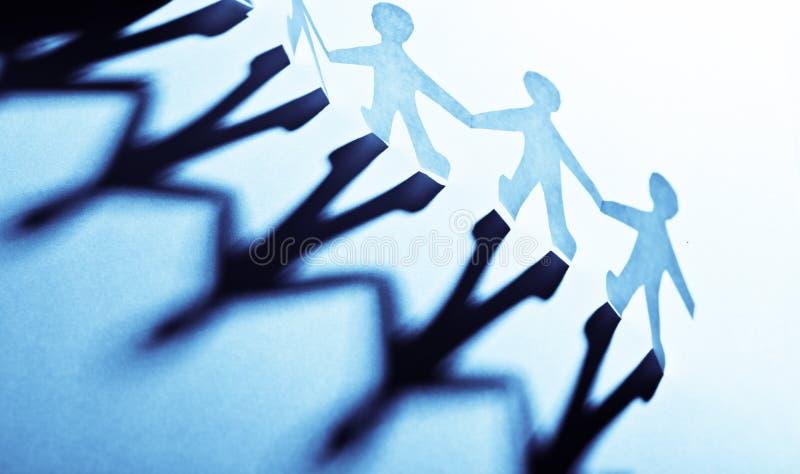 Leute des blauen Papiers in teamworking Konzept lizenzfreies stockbild