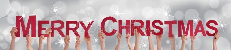 Leute, die frohe Weihnachten halten vektor abbildung