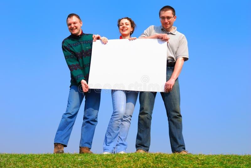 Leute mit mit Leerbeleg lizenzfreies stockbild