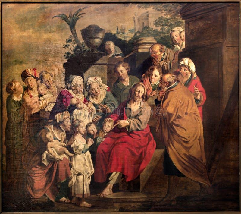 Leuven - Jesus en de kinderenscène. Verf in st. Peters gotische kathedraal stock afbeelding