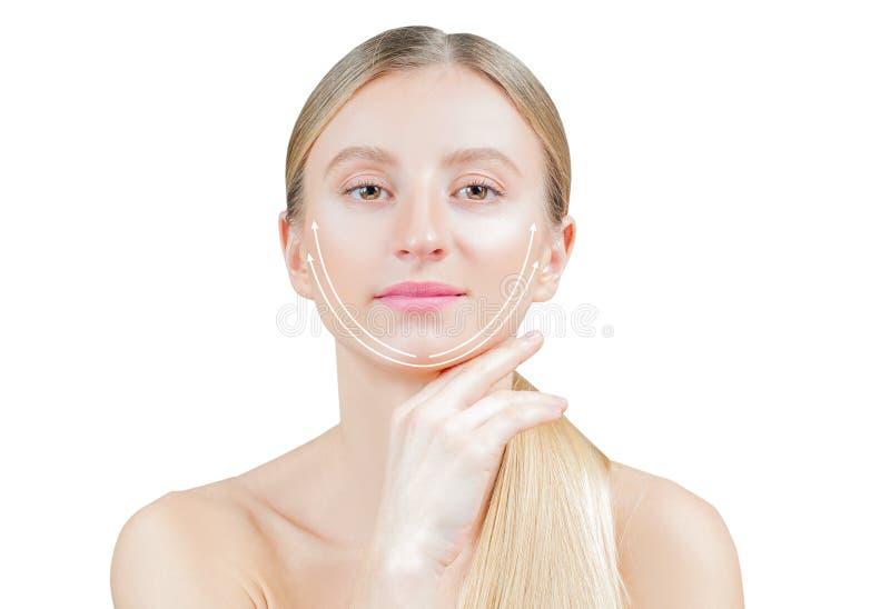 Levage anti-vieillissement de traitement et de visage Belle femme avec la peau parfaite avec des flèches sur le visage photos libres de droits