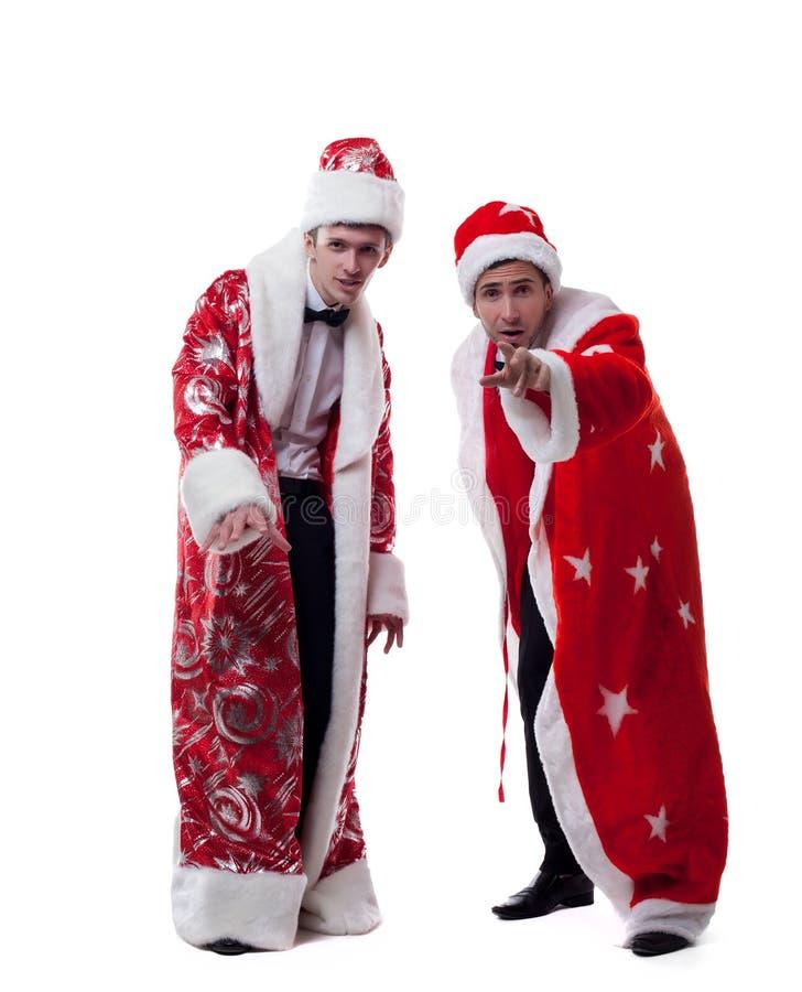 Levantamento bonito dos jovens vestido como Santa Claus fotos de stock royalty free