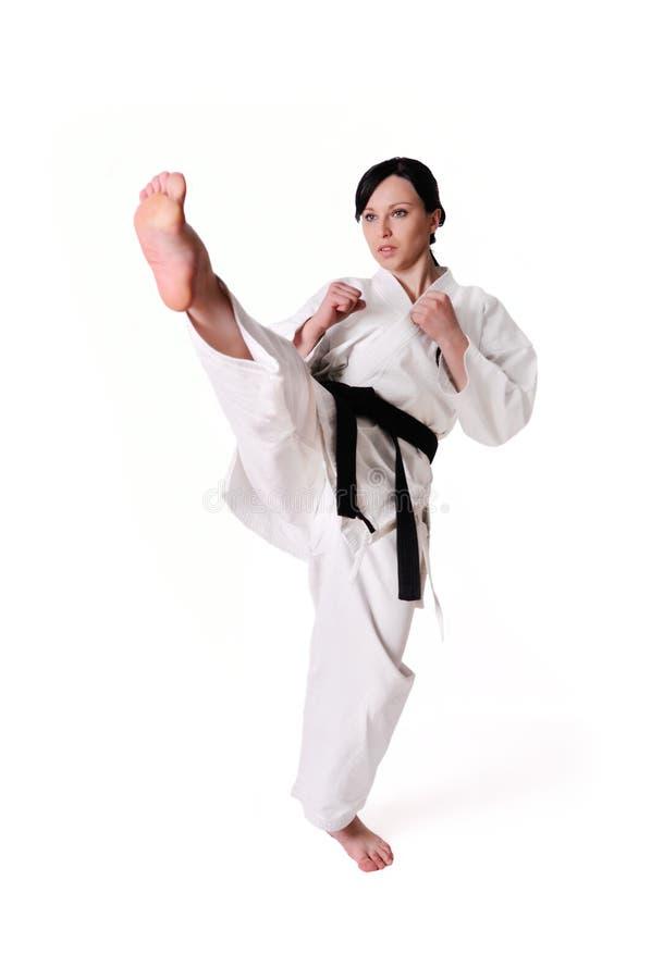 Levantamento da mulher do karaté fotografia de stock