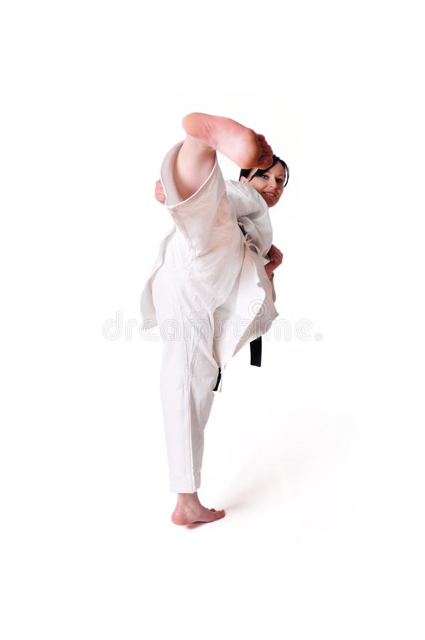 Levantamento da mulher do karaté foto de stock