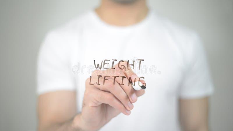 Levantamento de peso, escrita do homem na tela transparente imagens de stock royalty free