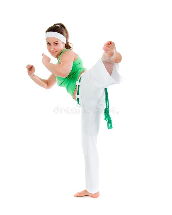 Levantamento do dançarino do capoeira da menina imagens de stock