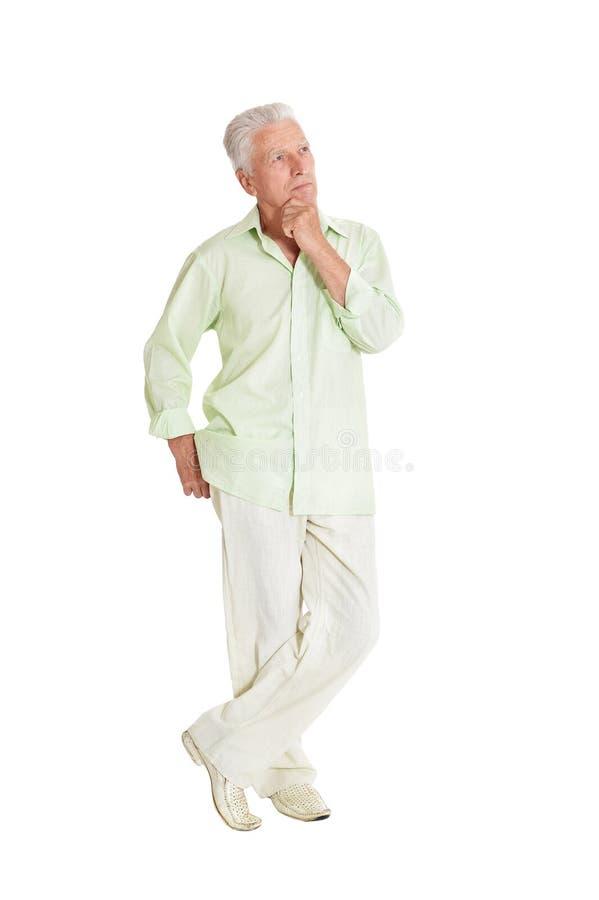 Levantamento feliz do homem superior isolado no fundo branco foto de stock royalty free