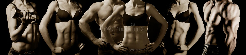 Levantamiento de pesas. Hombre y mujer foto de archivo