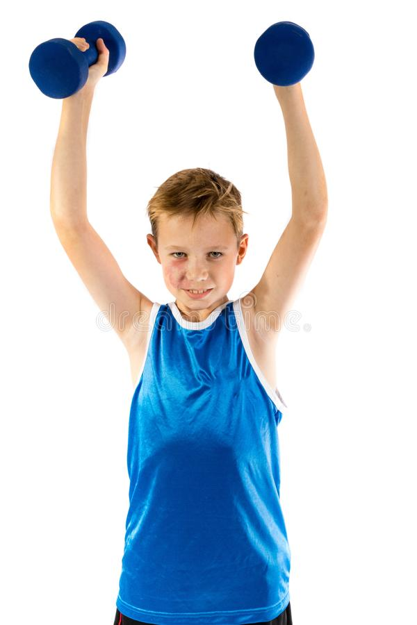 levantar peso Pre-adolescente do menino fotografia de stock royalty free